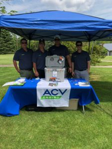 acv enviro employees behind table